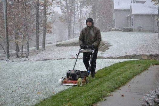 mowing snow, lawnmower in snow,spring snow, delaware, sussexcounty