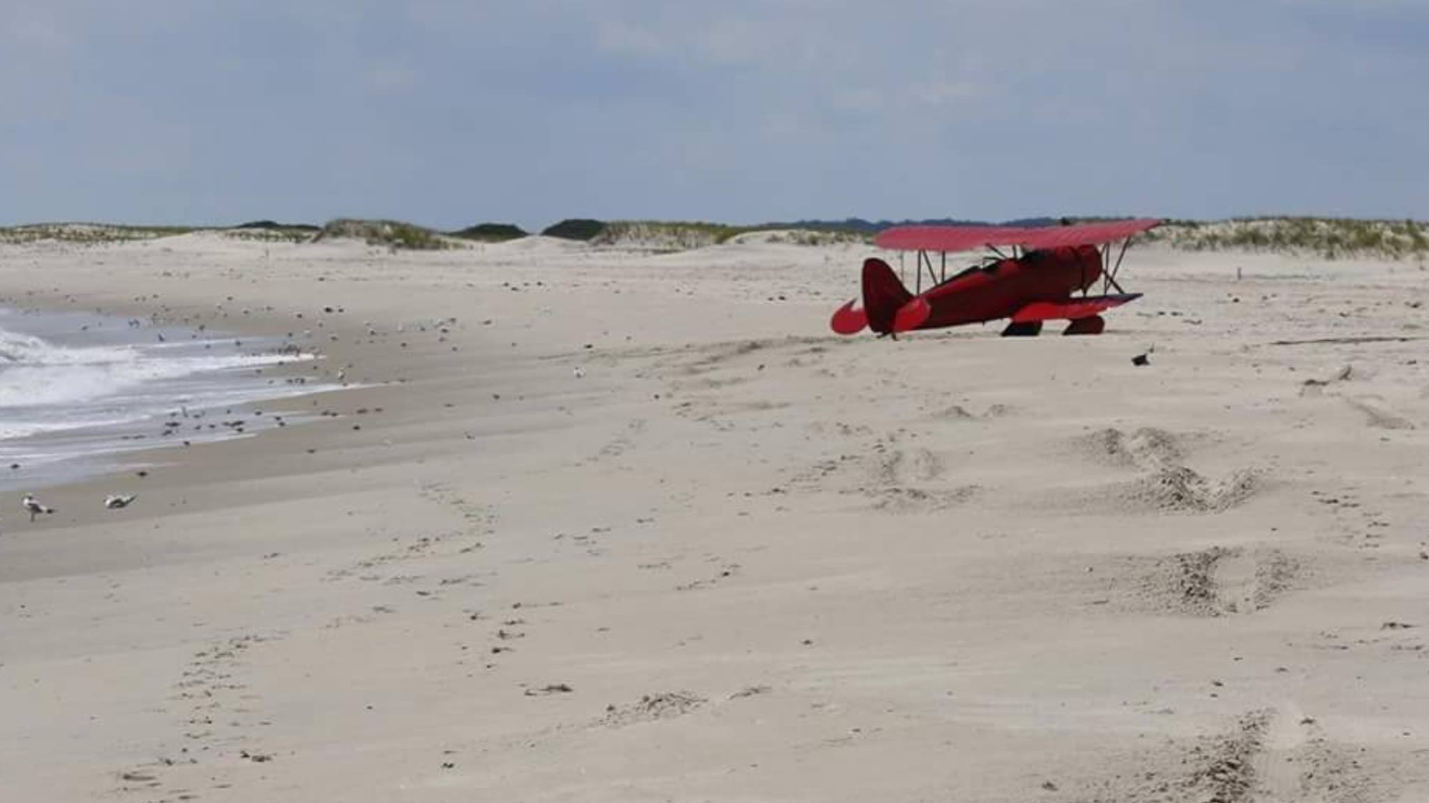 Biplane lands on assateague island delaware surf for Island beach state park fishing report