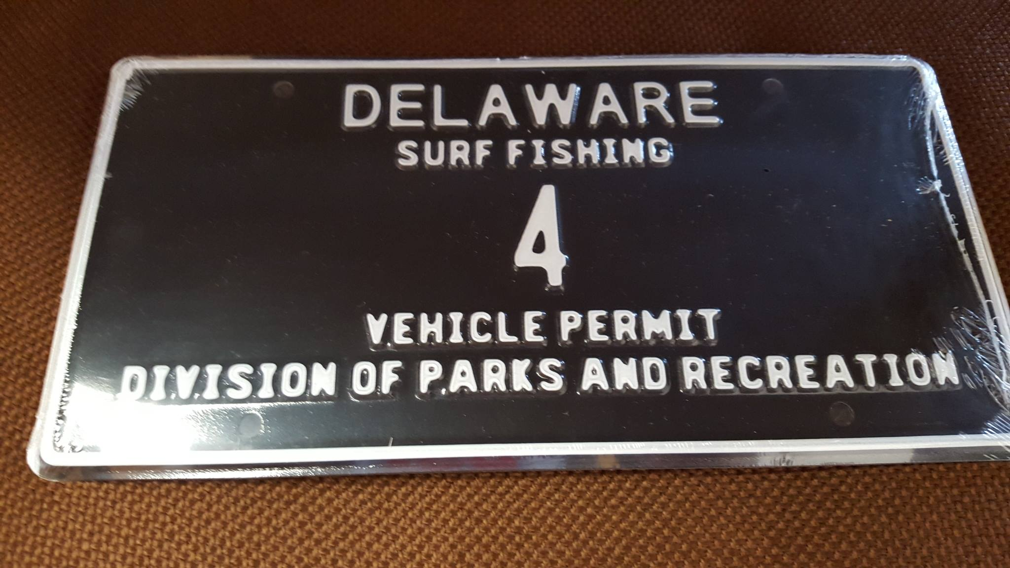Delaware Surf Fishing tag number 4, low digiti surf tags, sussex county, state parks,beach tags, drive on access, ORV permits,